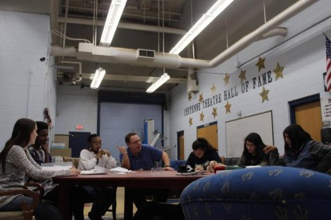 Cast members with Mr. McLemore read through the script of La Gringa.